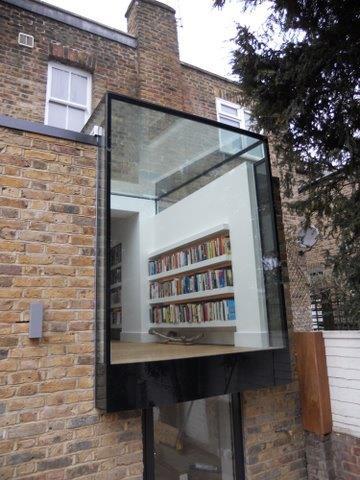 домашняя библиотека с максимумом солнца - фото design-dautore.com