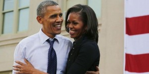 U.S. President Barack Obama and Michelle Obama smile at a campaign event at the University of Iowa
