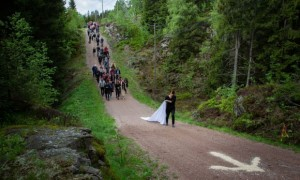 Han leads a procession through Nordmarka forest